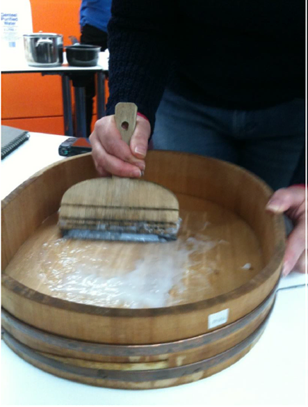Starch Paste being worked up by participant using traditional method. Note the hand and finger position on the brush.