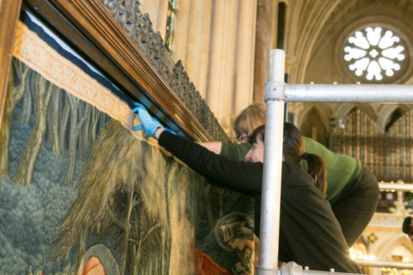 Installation of the tapestry into the wall frame. Image: Studio8 Ltd